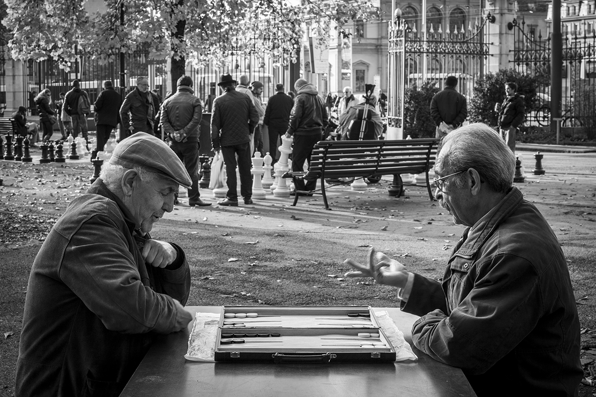 It's Your Move Two men sit playing backgammon at Parc des Bastions in Geneva, Switzerland